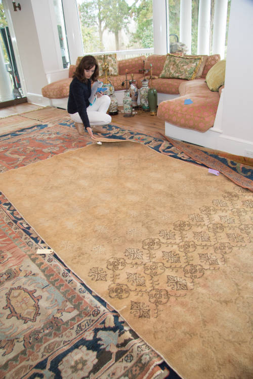 image of NouvelleView team member cataloguing a priceless rug as part of inventory collections management service